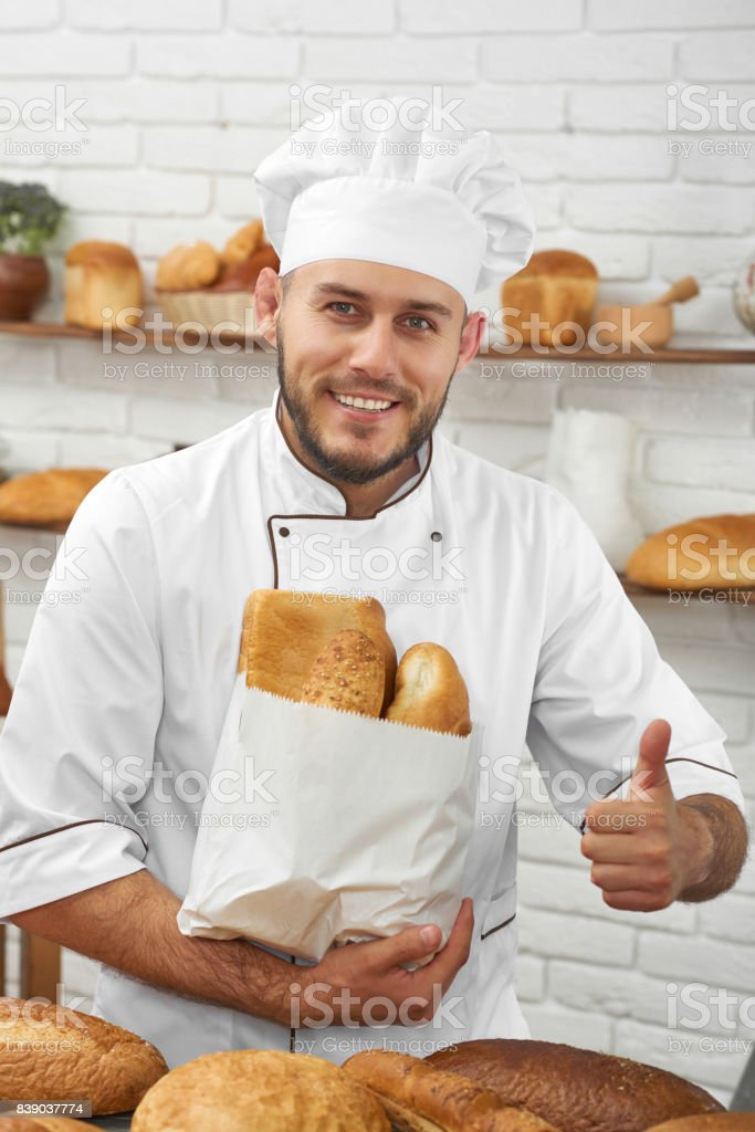 Professional baker working at his kitchen stock photo