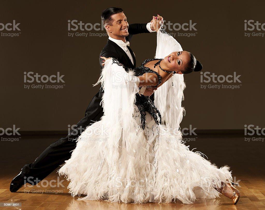 Professional ballroom dance couple preform an exhibition dance stock photo