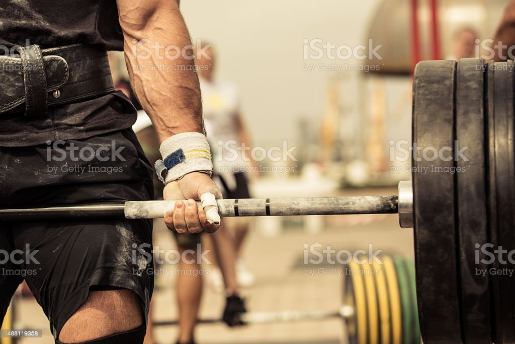 Professional bodybuilder workout with barbell stock photo
