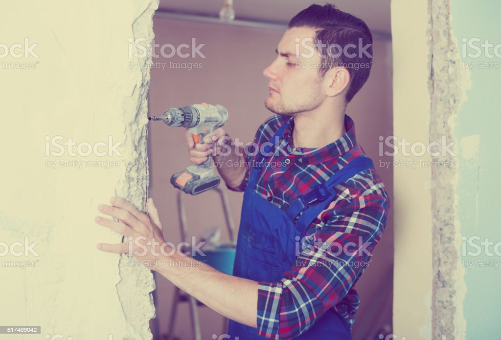 Professional builder drilling stock photo