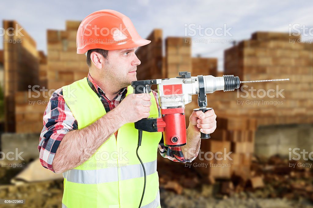 Professional builder with drill machine stock photo