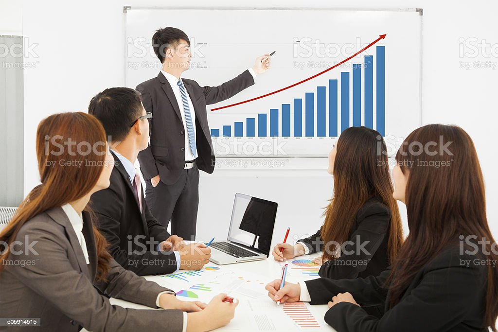 professional business man showing a market situation chart stock photo
