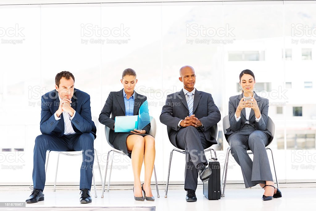 Professional business people waiting for their turn royalty-free stock photo
