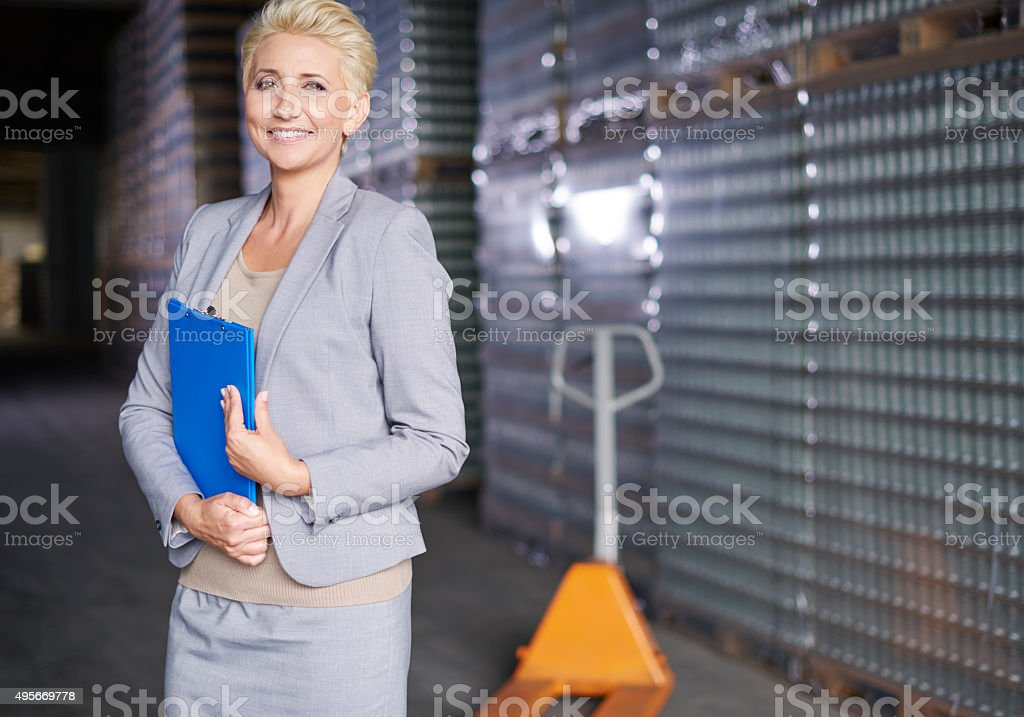 Professional business woman at warehouse stock photo