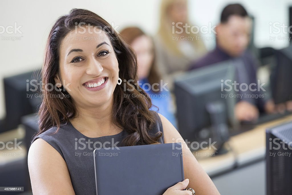 Professional businesswoman taking corporate training class in computer lab stock photo