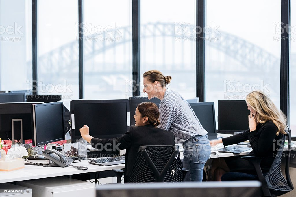 Professional businesswomen in Australian office working on computers stock photo