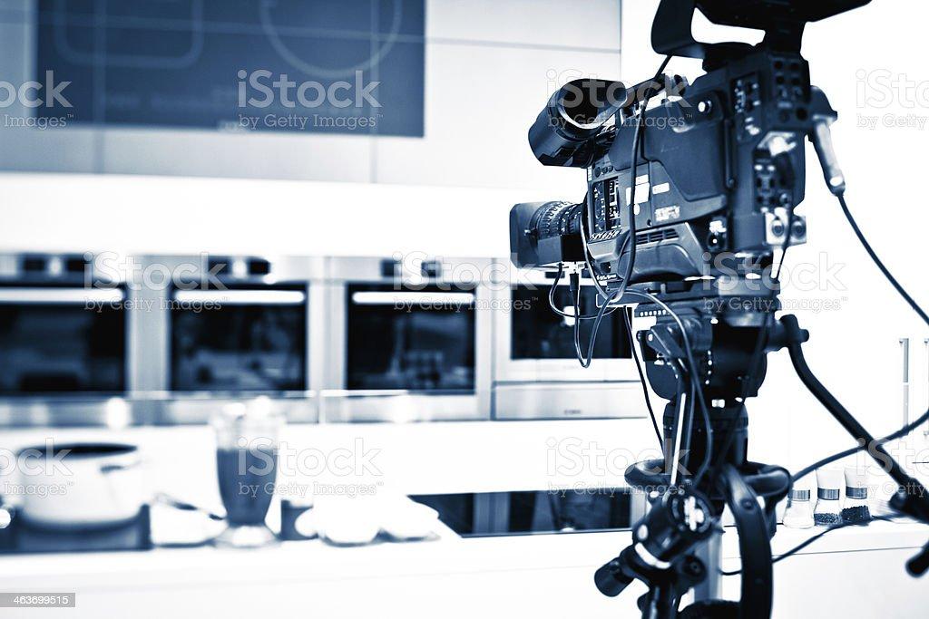 professional camera against TV studio background