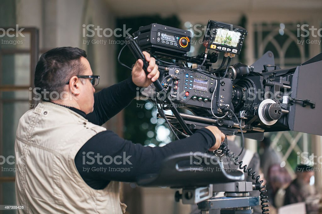 Professional camera man at work stock photo