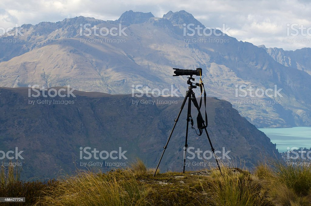 Professional camera with telephoto lens stock photo