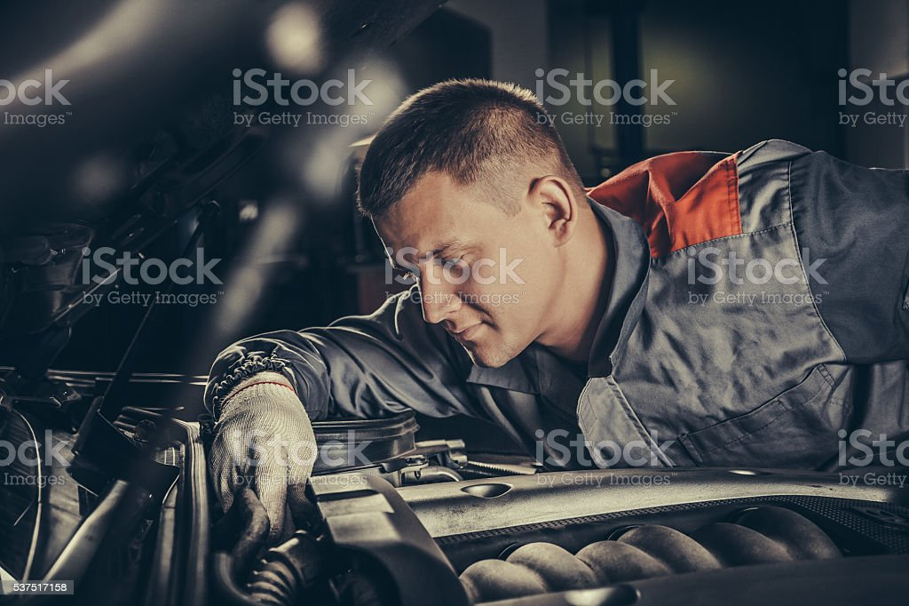 Professional car mechanic working in auto repair service stock photo