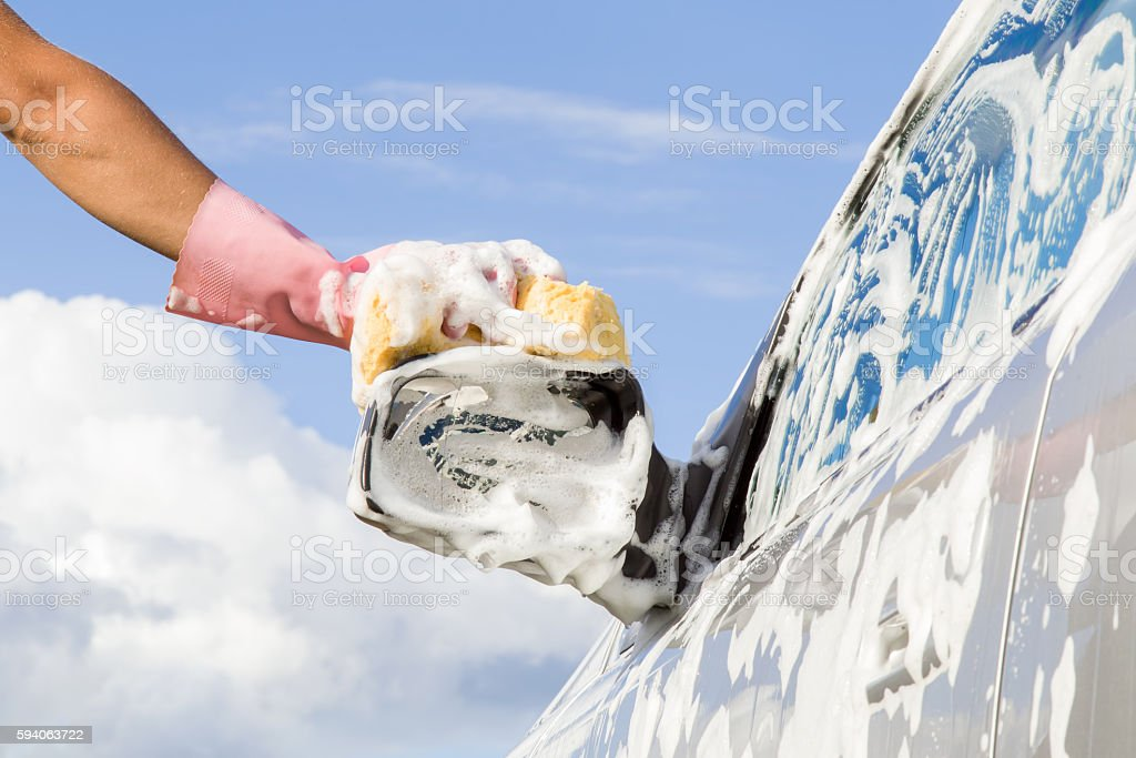 Professional car wash by hands. Early spring cleaning. stock photo