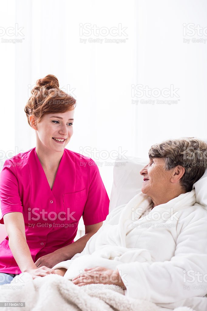 Professional carer and elderly patient stock photo