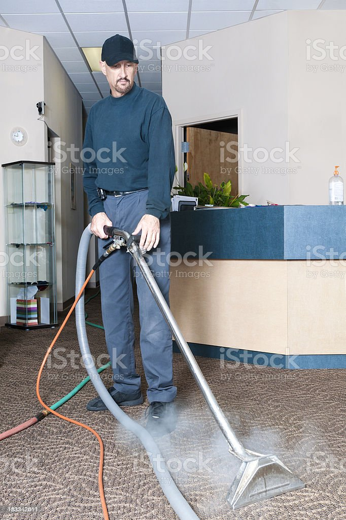Professional Carpet Cleaner - Steam Cleaning royalty-free stock photo