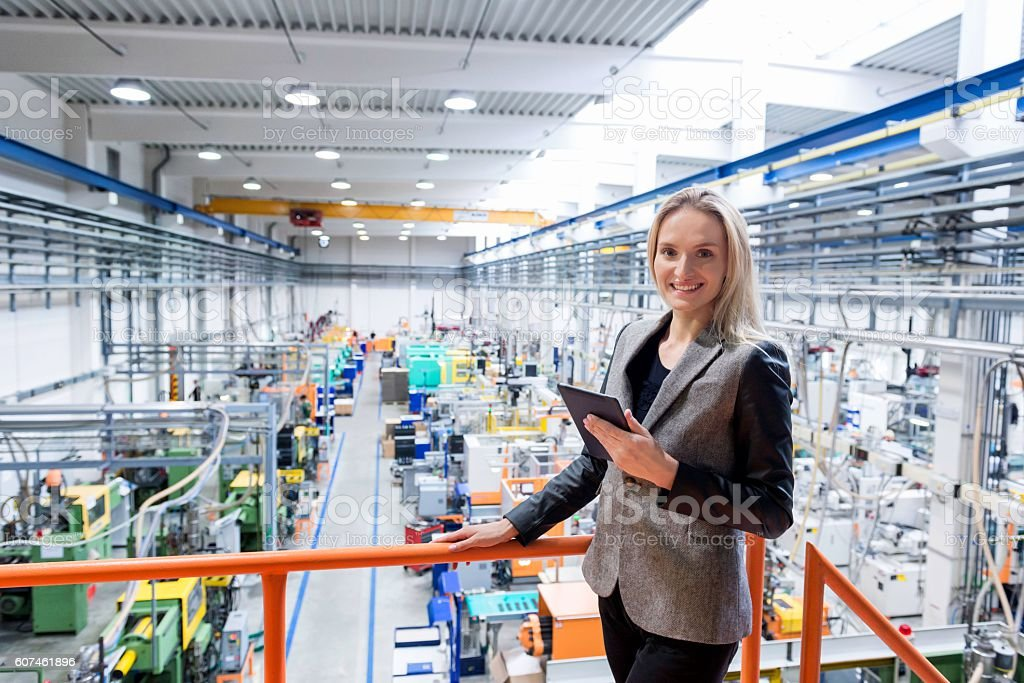Professional 'cheese' at factory! stock photo