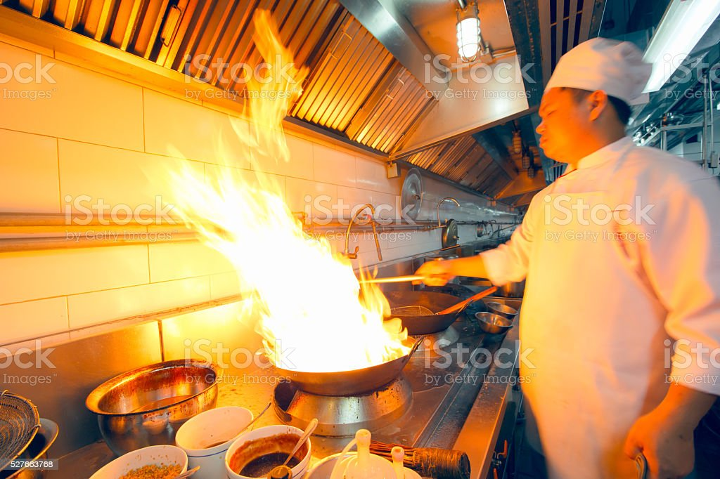 Professional chef cooking stock photo