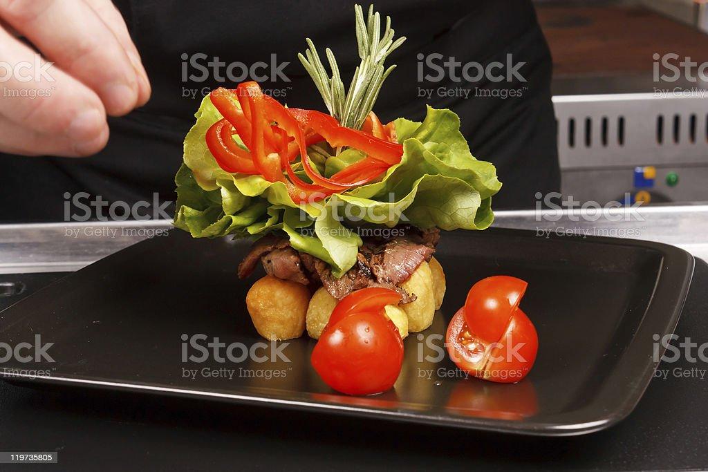 professional chef garnish tasty dish royalty-free stock photo
