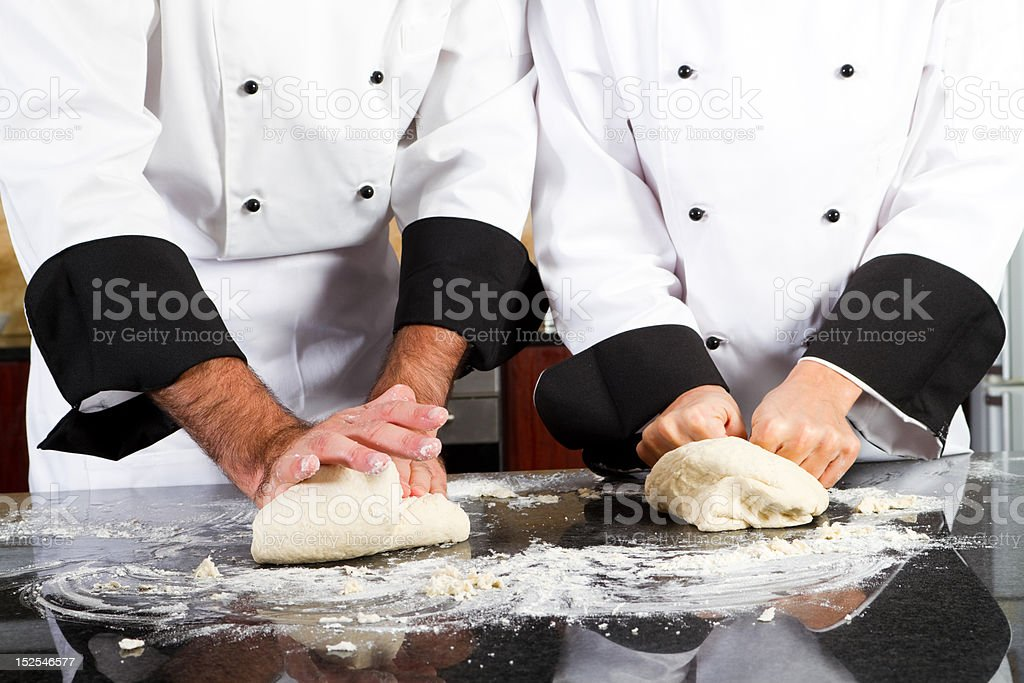 professional chef hands kneading bread dough stock photo
