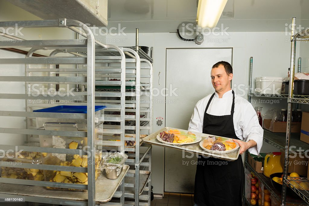 Professional Chef in a commercial fridge stock photo