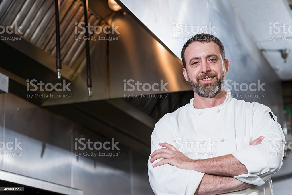 Professional chef in a commercial kitchen stock photo