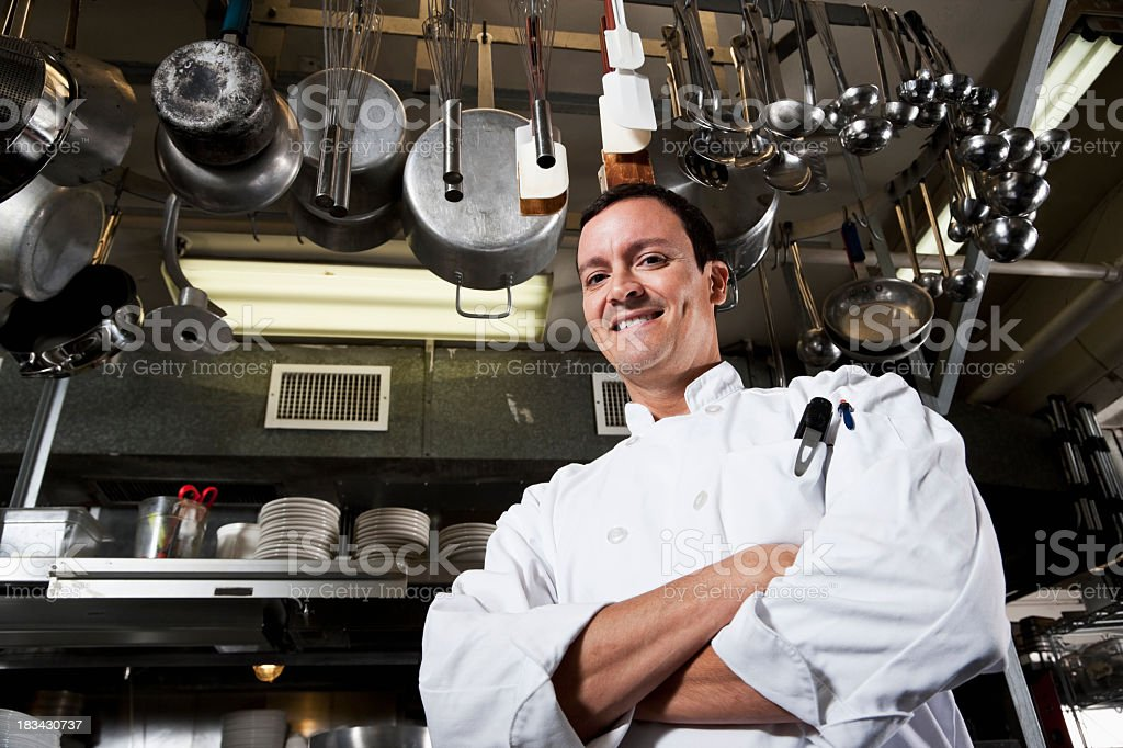 Professional chef in commercial kitchen stock photo