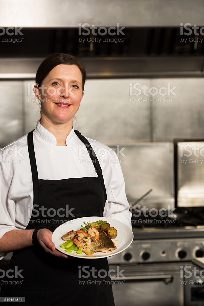 Professional chef with a prepared dish stock photo