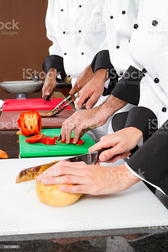 professional chefs preparing food royalty-free stock photo