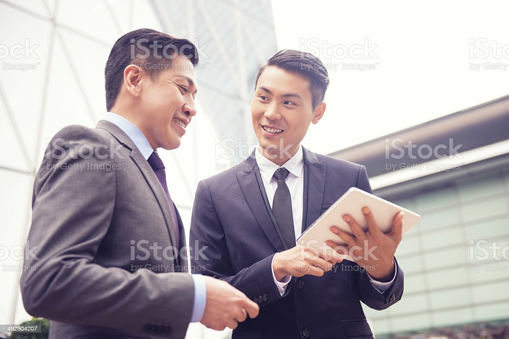 Professional Chinese Business Men Financial Consultation in Hong Kong stock photo