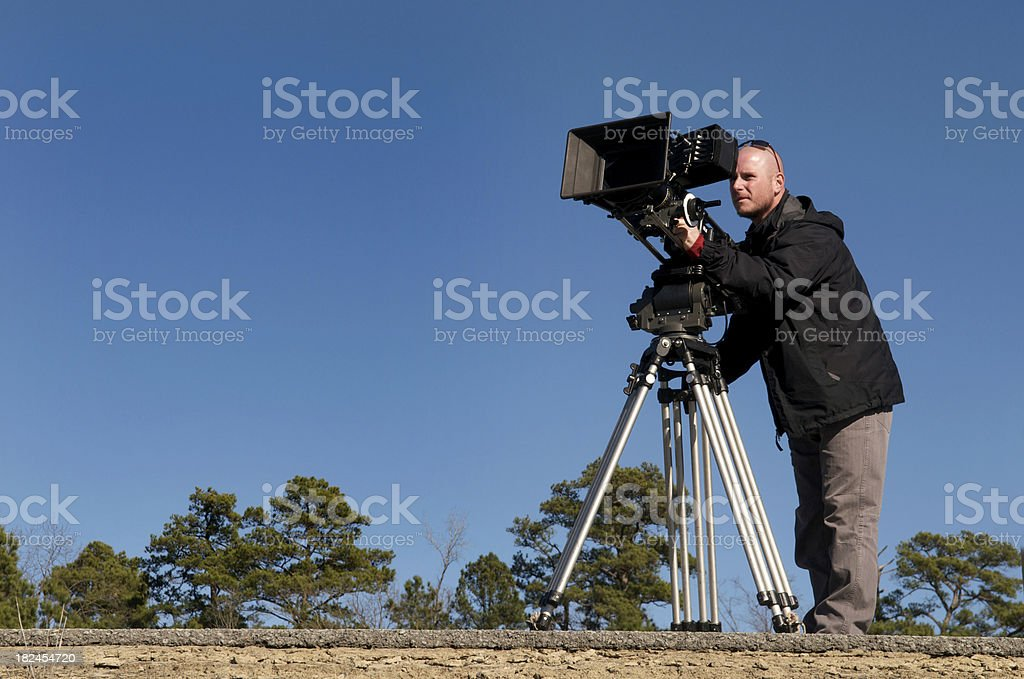 Professional Cinematographer or Videographer at Work royalty-free stock photo
