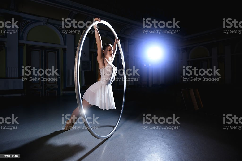 Professional circus performer rotate on cyr wheel stock photo