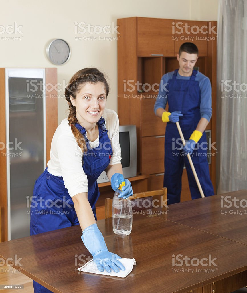 Professional cleaners in uniform stock photo