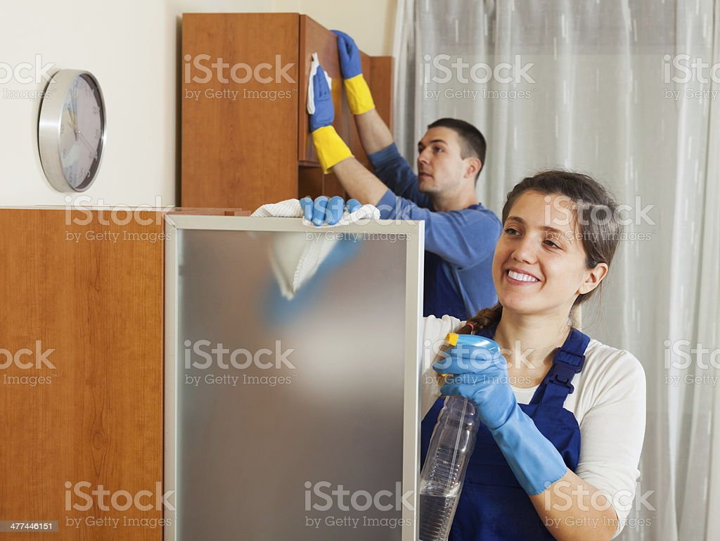 Professional cleaners team working stock photo