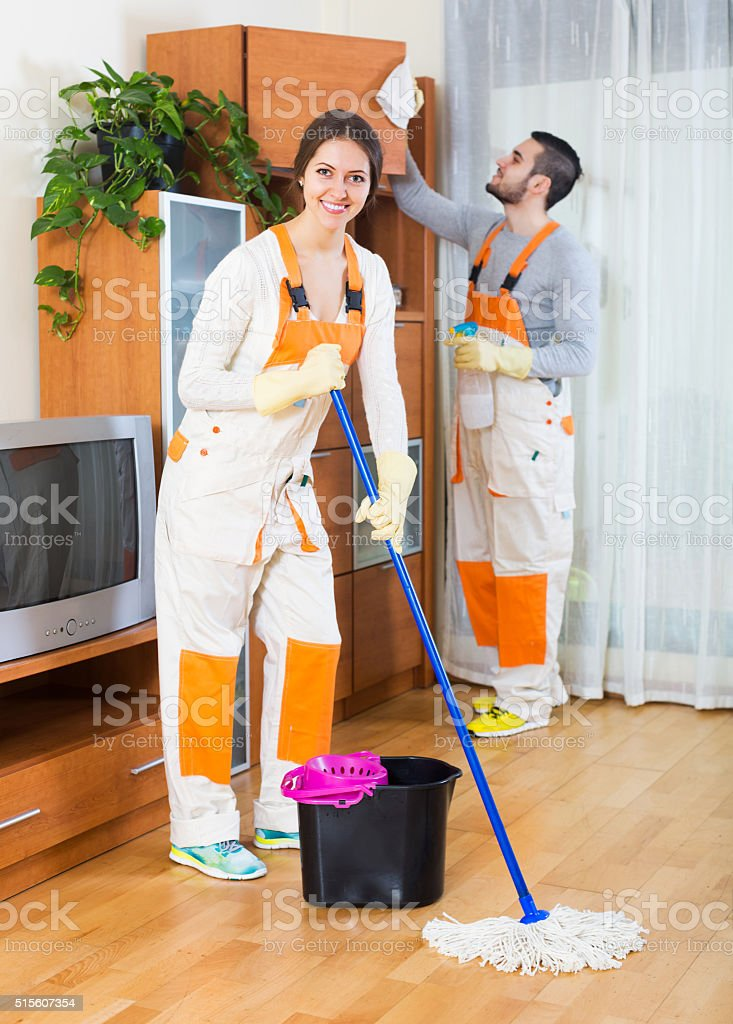 Professional cleaners with equipment clean stock photo