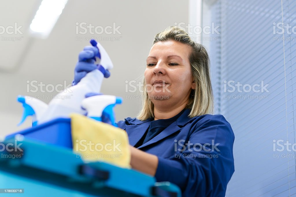 Professional cleaning woman cleaning an office stock photo