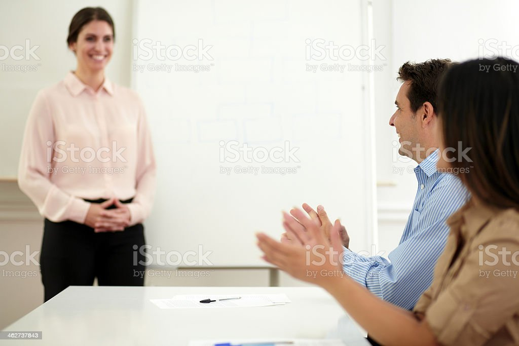 Professional colleagues giving applause on meeting stock photo