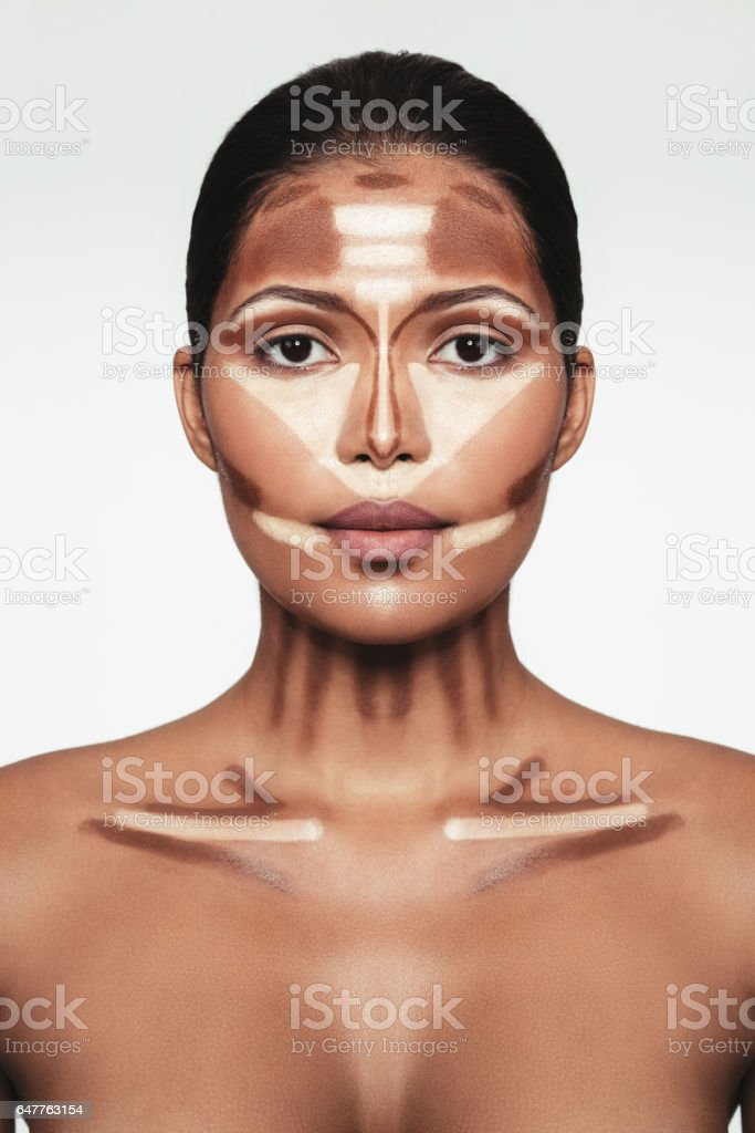 Professional contouring face makeup technique stock photo