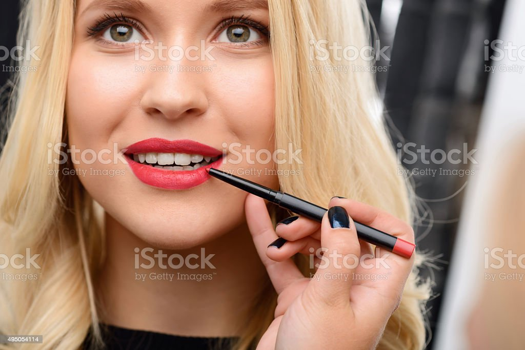 Professional cosmetics are being applied stock photo