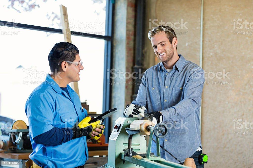 Professional craftsmen working in workshop stock photo