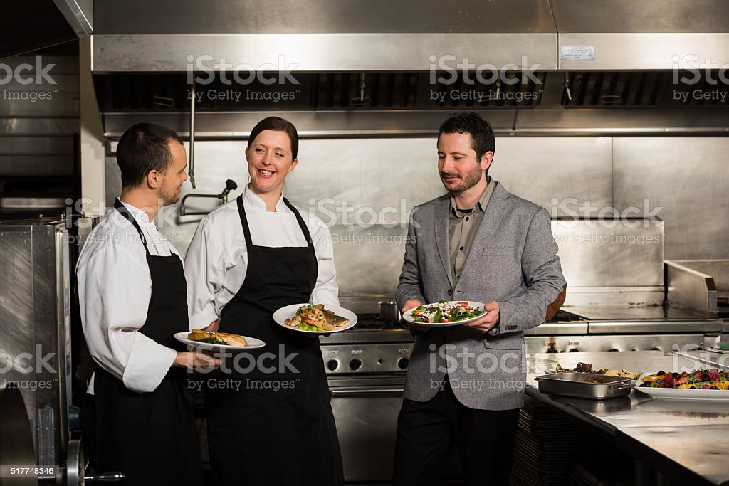 Professional culinary team in the kicthen stock photo