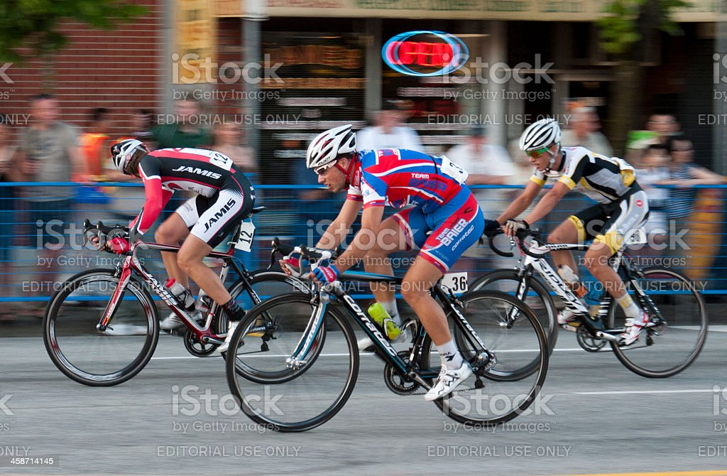 Professional Cyclists and a blur of spectators stock photo