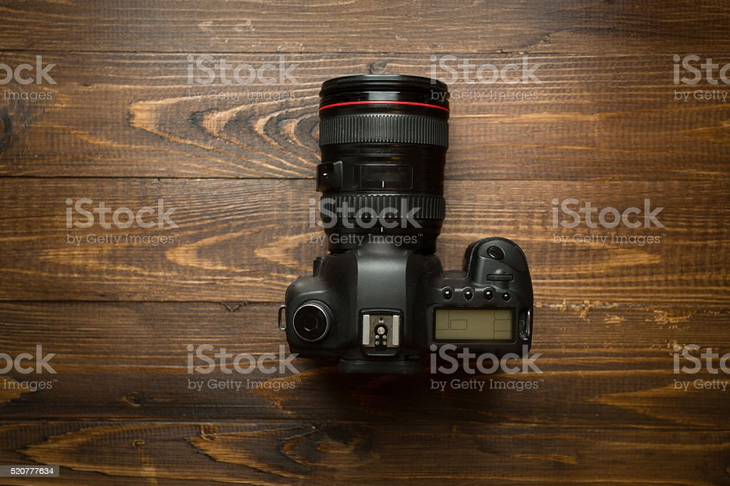 Professional digital camera on wooden background stock photo