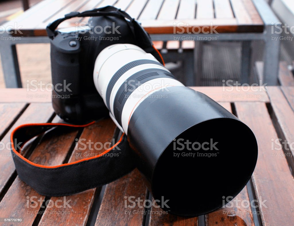 Professional digital photo camera with tele lenses stock photo