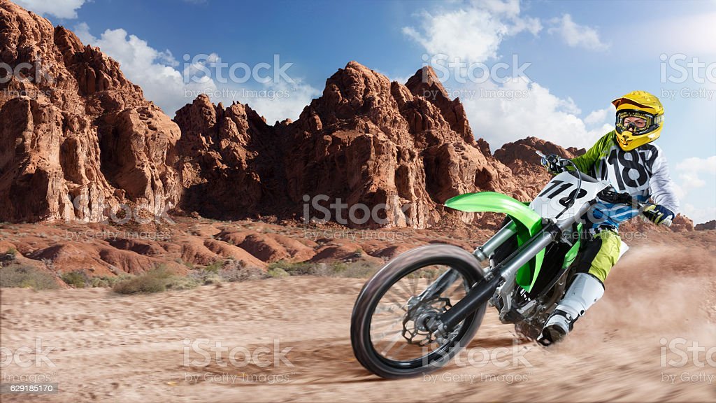 Professional dirt bike rider racing on the desert stock photo