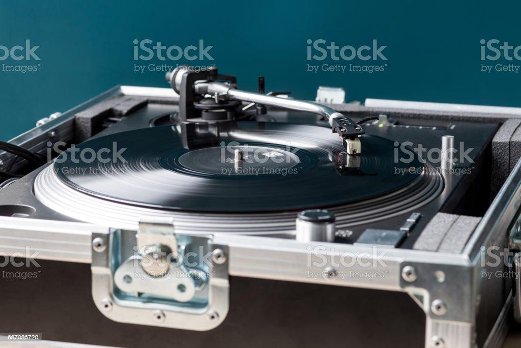 Professional DJ Turntable in Flightcase Playing Record stock photo