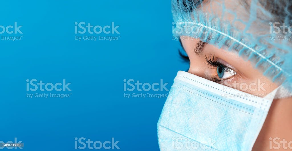 Professional doctor at work blue background stock photo