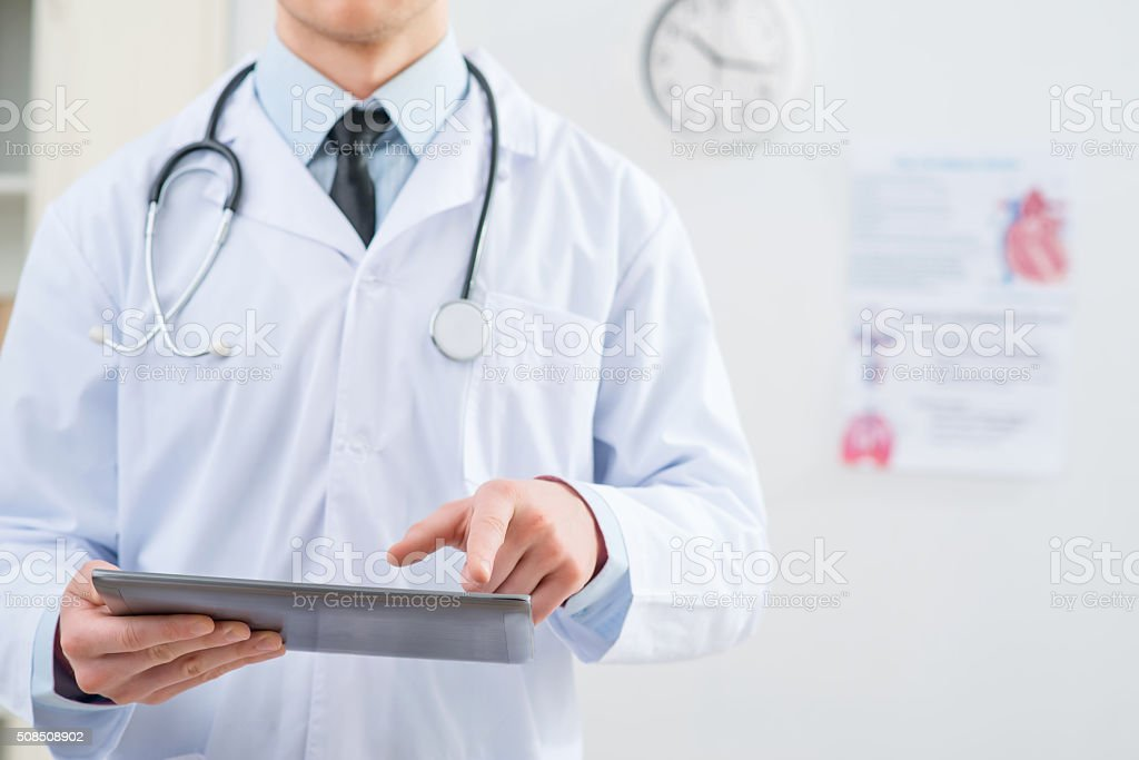 Professional doctor holding tablet stock photo