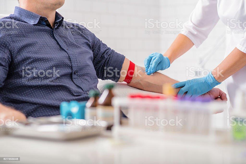 Professional doctor preparing patient for procedure stock photo