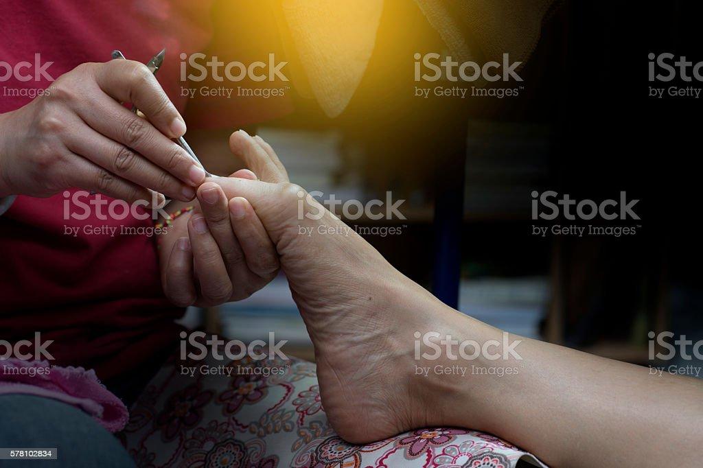 professional doing manicure pedicure stock photo