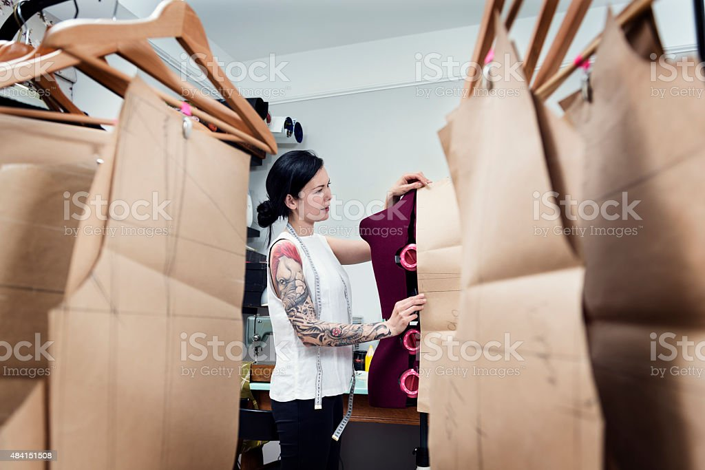 Professional Dressmaker At Work In Her Studio stock photo