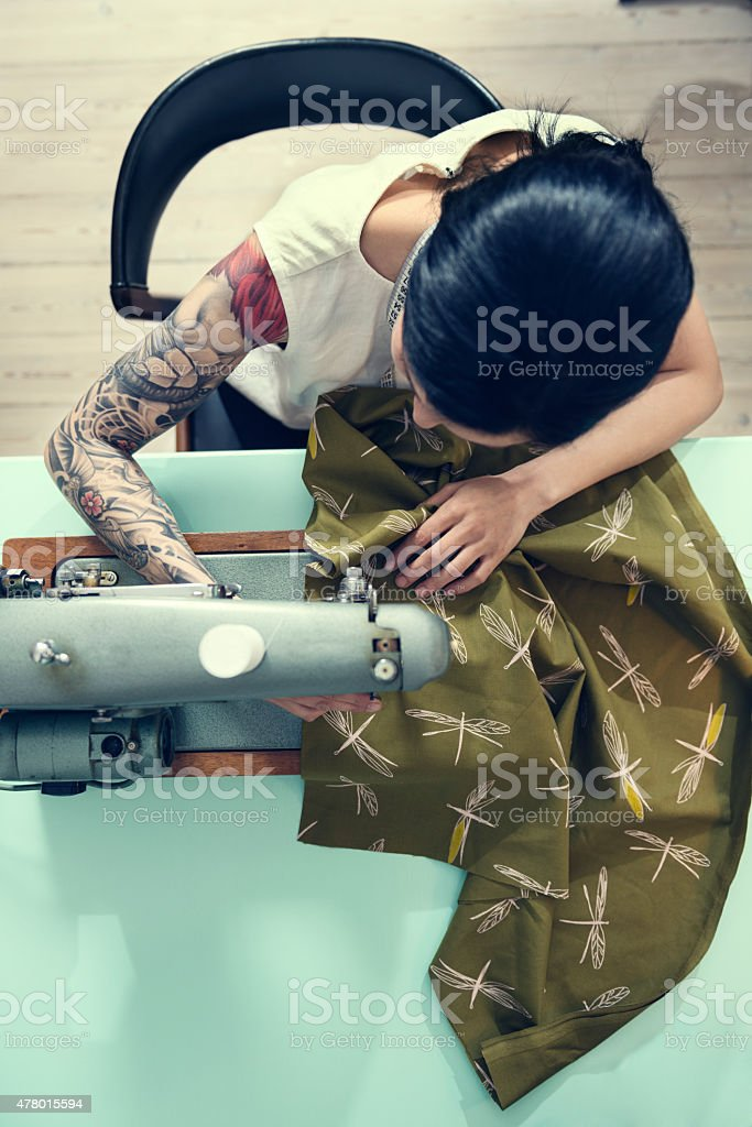 Professional Dressmaker At Work stock photo