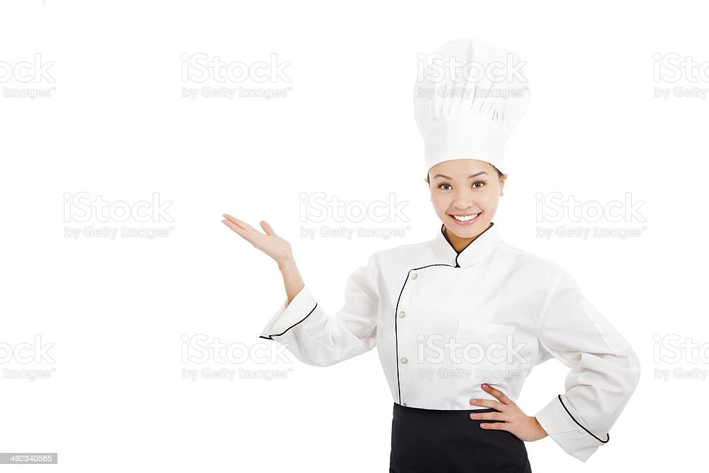 professional female cook raise hands to show something stock photo